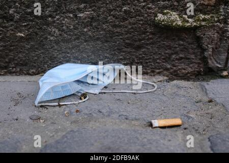 A protective face mask is seen discarded on the ground in Toulouse, France, on June 27, 2020. As the use of masks and gloves sky-rocketed to protect the humanity from the coronavirus pandemic, their impact on environment also rose, with the worrying consumption of plastic and its disposal. Many fear the progress of eliminating single-use plastic is now being undone, as these protection tools are already being seen polluting the environment. Photo by Patrick Batard/ABACAPRESS.COM - Stock Photo