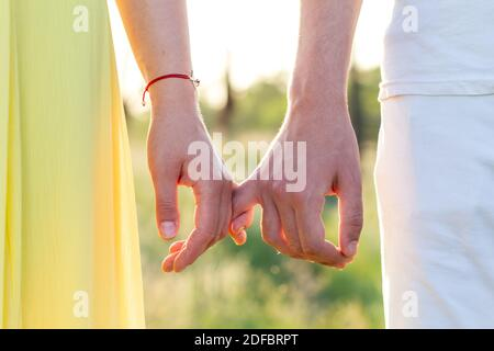 Men's and women's hands of lovers, two men gently hold hands. Love forever, touch and romance