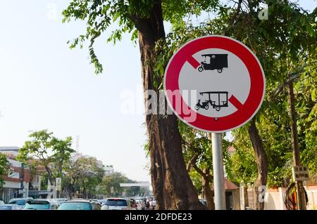 No rickshaws forbidden roadsign. Motor rickshaw, tuk tuk and three wheeler prohibited sign on the streen. Phnom Penh, Cambodia. - Stock Photo