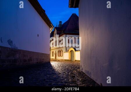 Narrow historical alley in the old town of Bamberg at night, World Heritage Site City of Bamberg, Germany