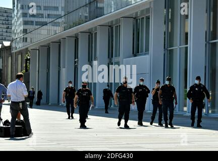 Policemen with weapons and masks pass in front of the High Court of Paris (TGI), Porte de Clichy, during the trial of the Charlie Hebdo, Montrouge and the Hyper Cacher opened this Wednesday, for two months, before the Special Assize Court of Paris. Judicial Court of Paris, on September 2, 2020. Photo by Karim Ait Adjedjou/Avenir Pictures/ABACAPRESS.COM