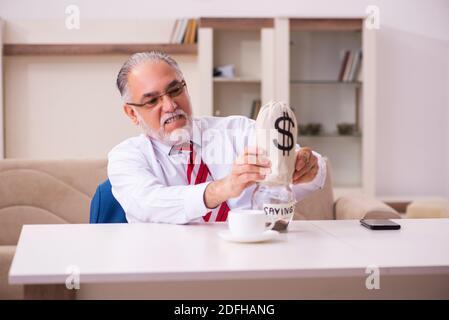 Senior male boss employee in retirement concept