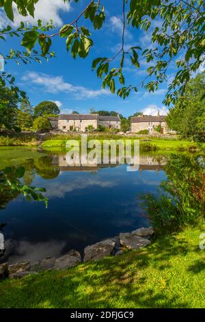 View of village pond and cottages, Monyash, Peak District National Park, Derbyshire, England, United Kingdom, Europe Stock Photo