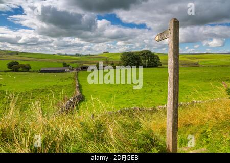 View of footpath sign and farmland, Tissington, Peak District National Park, Derbyshire, England, United Kingdom, Europe Stock Photo