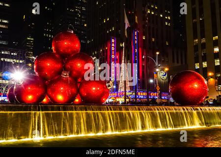 Christmas Holiday decorations in New York City with Radio City Music Hall Christmas Tree in the background. New York, USA.