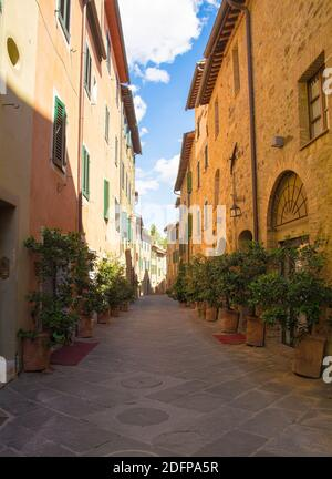 A residential road in the historic medieval village of San Quirico D'Orcia, Siena Province, Tuscany, Italy
