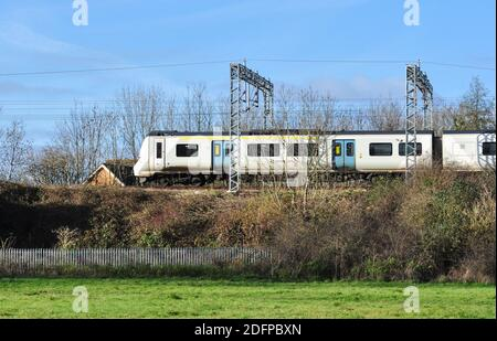 Southbound Class 700 EMU passes Walsworth Common on its way into Hitchin, Hertfordshire, England, UK - Stock Photo