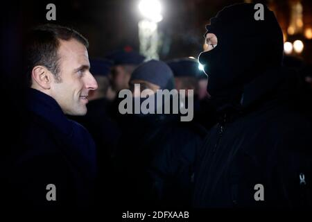 French President Emmanuel Macron meets hooded police forces near the Christmas market in Strasbourg, eastern France, Friday, Dec.14, 2018. A fourth person died Friday from wounds suffered in an attack on the Christmas market in Strasbourg, as investigators worked to establish whether the main suspect had help while on the run. Photo by Jean-Francois Badias Pool/ABACAPRESS.COM Stock Photo