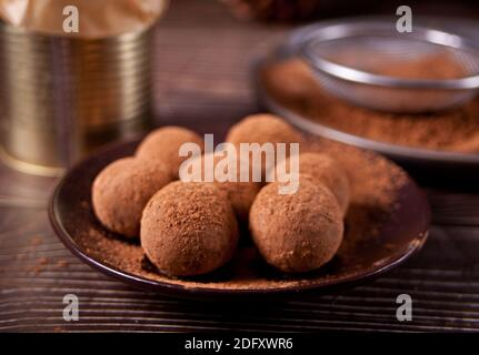 homemade chocolate balls truffles on the plate