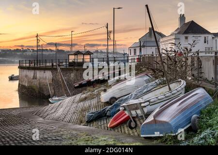 Appledore, North Devon, England. Monday 7th December 2020. UK Weather. After a very cold night in North Devon, a layer of frost covers the small boats tied up along the quay at the coastal village of Appledore. Credit: Terry Mathews/Alamy Live News - Stock Photo