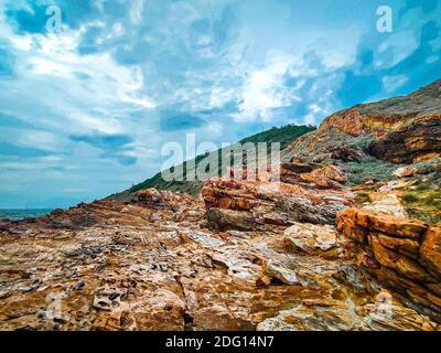 coast rock mountain at Khao Laem Ya National Park Rayong Thailand against blue sky background.