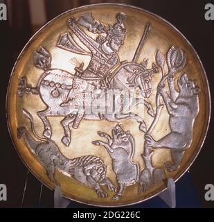 Sasanian gold-plated silver dish depicting the King hunting a lion, a boar and a bear, Tabriz Museum, Iran.