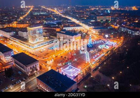 Gomel, Belarus. Main Christmas Tree And Festive Illumination On Lenin Square In Homel. New Year In Belarus. Aerial Night View