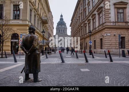 Budapest, Hungary - March 28, 2018: The Fat Policeman statue in Budapest city, Hungary. Rubbing the jolly fat policeman's stomach is said to bring goo