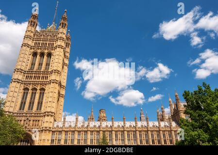 British Parliament Building Westminster in London UK on a brilliant sunny day and a blue sky.
