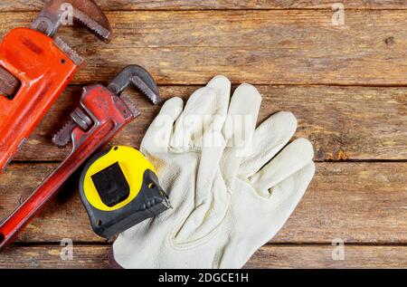 Wrench plumbing leather safety gloves construction concept.