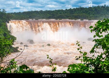 View of muddy Iguazu Falls at the border of Argentina and Brazil
