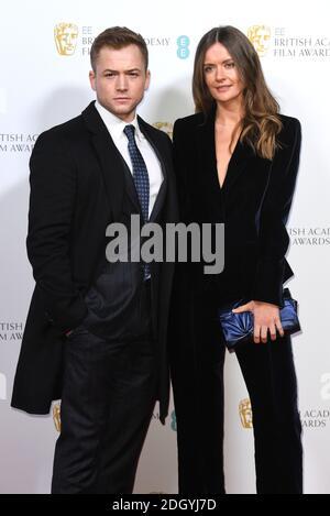 Taron Egerton and Emily Thomas attending The British Academy Film Awards Nominees' Party at Kensington Palace, London. Photo credit should read: Doug Peters/EMPICS