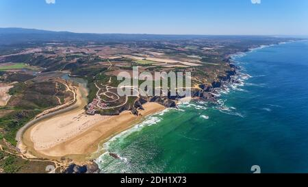 Aerial panorama of the village and Odeceixe beach, in summer overlooking the Algarve. Portugal
