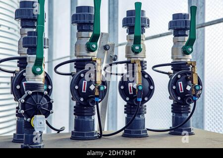 Valves, cables and piping as found inside of a modern industrial power plant