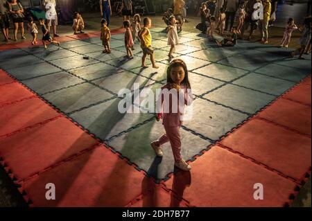 Young children playing Halloween night on Nguyen Hue Walking Street, Ho Chi Minh City, Vietnam