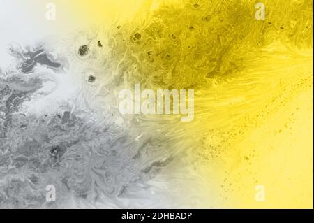 Trend abstraction of yellow and gray acrylic paint on a white background