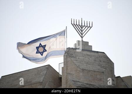 Very high resolution late afternoon view of an Israeli flag flying next to a menorah near the top of a building opposite the Western Wall in the Old City of Jerusalem on Thursday, November 2, 2017.Photo by Ron Sachs / CNP/ABACAPRESS.COM - Stock Photo