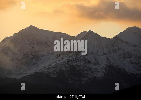 Sunset over the Snowdon horseshoe across showing recent snowfall. Wales.   Picture taken 5th December 2020