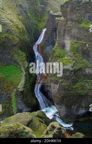 Waterfall on the Fjaðrá river flowing through the Fjaðrárgljúfur / Fjadrargljufur canyon near Kirkjubæjarklaustur in summer, Iceland