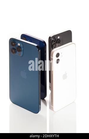 Bratislava, Slovakia - December 07, 2020. Various iPhone 12 smartphones isolated on white.