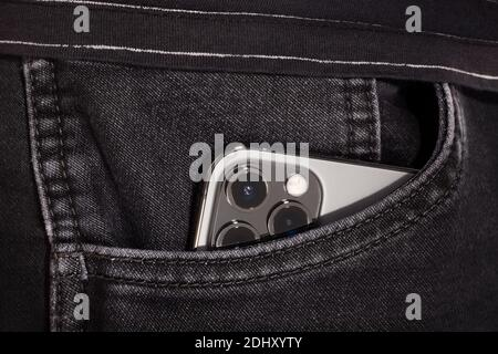 Bratislava, Slovakia - December 07, 2020. iPhone 12 Pro Max Graphite in jeans pocket.