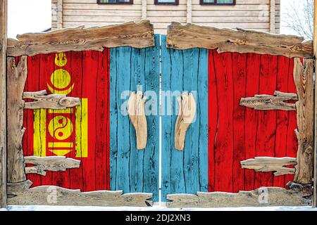Close-up of the national flag of Mongolia on a wooden gate at the entrance to the closed territory. The concept of storage of goods, entry to a closed - Stock Photo