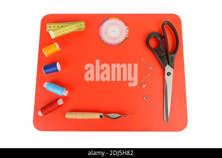 Composition with threads and sewing accessories isolated on white background. Sewing pattern. Flat lay, top view. Free space for text.