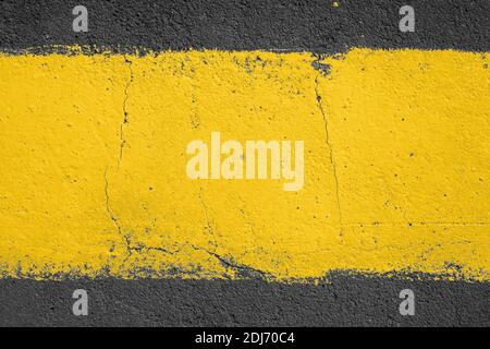 strip of yellow paint on the pavement. Use as frame or background