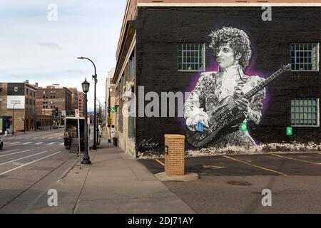 Painted wall mural of American singer, songwriter, musician, record producer, dancer, actor Prince in downtown Minneapolis, Minnesota.