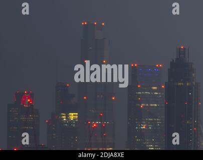 London, UK. 14 December 2020. City of London skyscraper illuminated before sunrise with christmas lights at Tower 42, previously the NatWest Tower (left), wearing a seasonal wooly jumper. Credit: Malcolm Park/Alamy Stock Photo
