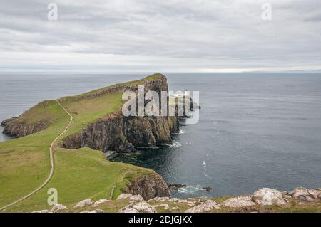 Neist Point lighthouse from Neist Cliff viewpoint, isle of Skye, Scotland. Concept: famous natural landscape, Scottish landscape, tranquility and serenity, power of the sea - Stock Photo