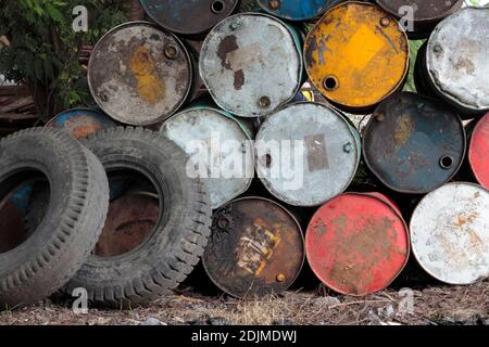 top of grunge barrels stacked in row - Stock Photo