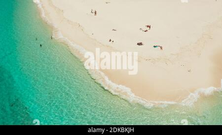 Tropical island with beautiful beach, and turquoise water view from above. Daco island, Philippines. Summer and travel vacation concept