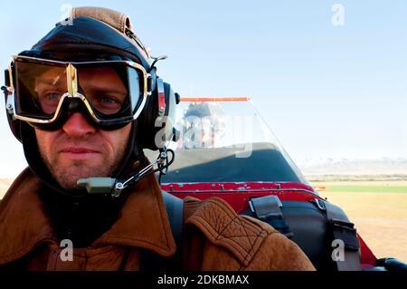 Man Traveling In Biplane
