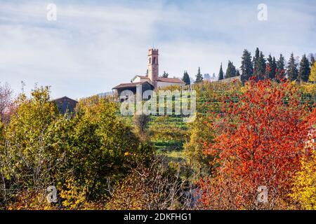 the oratory of the blessed virgin of sorrow on the hill of Combai, among the vineyards in autumn, Miane, Treviso, Italy, Europe