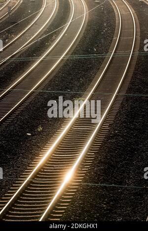 Essen, Ruhr area, North Rhine-Westphalia, Germany - train tracks in the backlight of the evening sun.