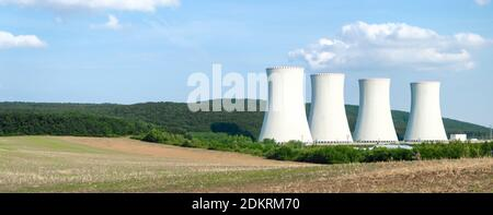 White chimneys of nuclear power plant. Sustainable energy. Banner with copy space.