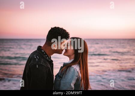 Young Couple In Love Kissing In Front Of The Sea