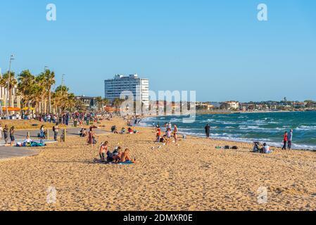 MELBOURNE, AUSTRALIA, JANUARY 1, 2020: People are enjoying a sunny day on a beach at St. Kilda, Australia
