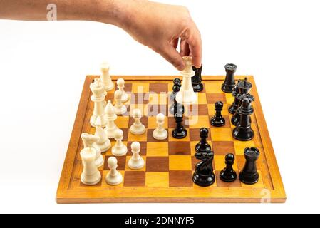Hand Moving Chess Piece - Isolated on White Background
