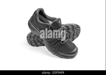 Moscow, Russia December - 19, 2018: Salomon XA TICAO GTX black sneakers on white background. Contagrip outsole. membrane Gore-Tex