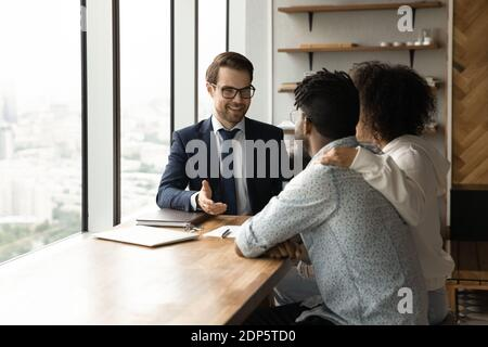 Male realtor have meeting with biracial couple clients