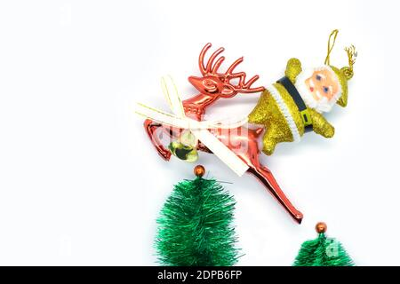 Santa on a reindeer traveling in the forests - Stock Photo