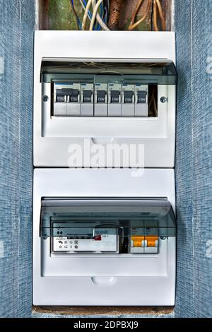 Home wiring system, new electronic electric meter box and distribution  board with circuit breakers. House energy meter and domestic electrical  fuse b Stock Photo - AlamyAlamy